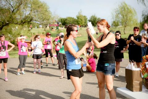 Race director Abbi Meadows (right) congratulates a finisher.